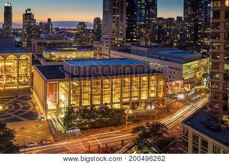 New York NY USA - June 1 2017. Sunset view of Lincoln Center Opera House Alice Tully Hall and New York City skyline.