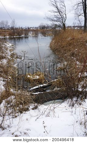 Water flows from the quarry pond towards a culvert in the Rock Run Preserve of Joliet, Illinois, during January.