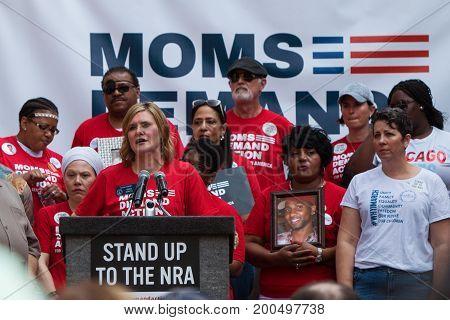 ATLANTA, GA - APRIL 2017: Georgia State Senator Elena Parent peaks at a Moms Demand Action anti-gun anti-NRA rally in Woodruff Park in Atlanta GA on April 29 2017.