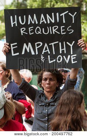 ATLANTA, GA - APRIL 2017:  A woman holds a sign saying