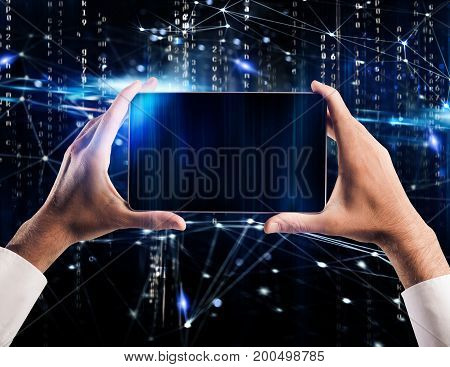 Man holds a tablet ready to connect with a internet network