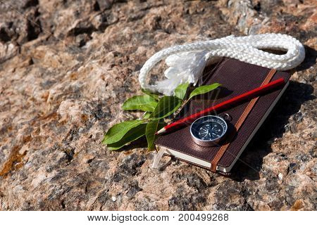 Notebook, Compass, Rope On Stone Background