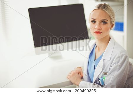 Doctor sitting at the table. Medicine and health care concept.