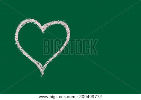 hand drawn pink chalk heart isolated on green school board background