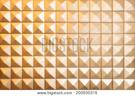 Abstract blur Pattern of pyramid shapes background. Wall of tiles.