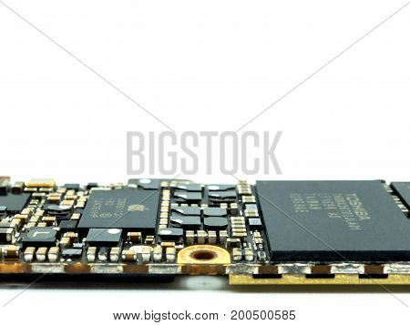 Chiang Rai Thailand: April 8 2017 - Close-up image of Apple iPhone logic board on white background with copy space.