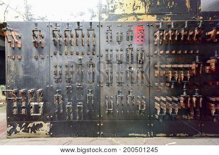 Vintage large old electrical breakers and meters.
