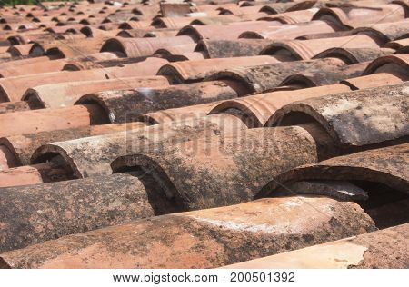 Roof tiles of a old house in the day