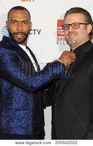 LOS ANGELES - AUG 15:  Omari Hardwick, Ric Roman Waugh at the
