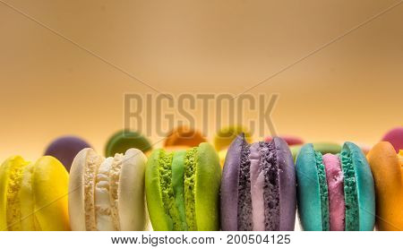 Colorful Macaron sweet and delicious on cream color background with copy space.