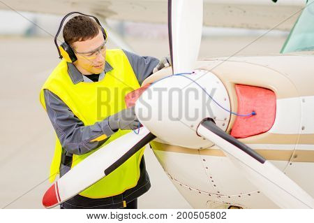 Male airport worker runway control happy maintenance