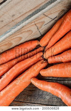 Fresh carrot on wooden surface, GMO free