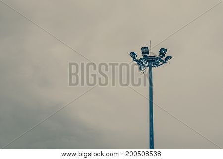 Lamp Post Electricity Industry With Blue Sky Background. Spotlight Tower, Vintage Tone.