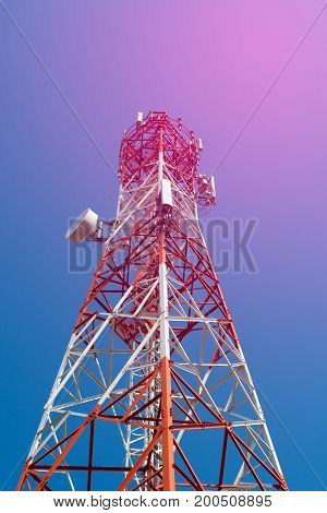 Mobile Phone Communication Antenna Tower With Satellite Dish On Blue Sky Background Soft Tone.