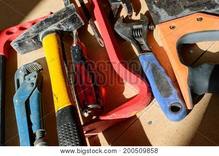 Dirty set of hand tools for house repairs on craft background