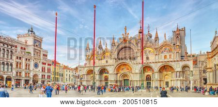 VENICE, ITALY - MAY 11, 2017 : Square of the Holy Mark (Piazza San Marco) and St. Mark's Cathedral (Basilica di San Marco) with tourists. Italy.