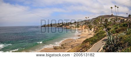 Overcast Summer sky over a bench and pathway at Divers Cove in Laguna Beach California.
