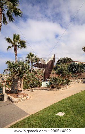Laguna Beach CA USA - August 19 2017: Metal sculpture of a whale called Breaching Whale by Jon Seeman in Heisler Park in Laguna Beach California. Editorial only.