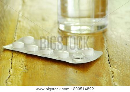 pill in blister pack should be eating with fresh water on table