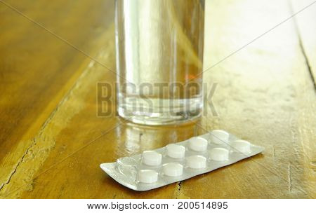medicine in blister pack should be eating with fresh water on table