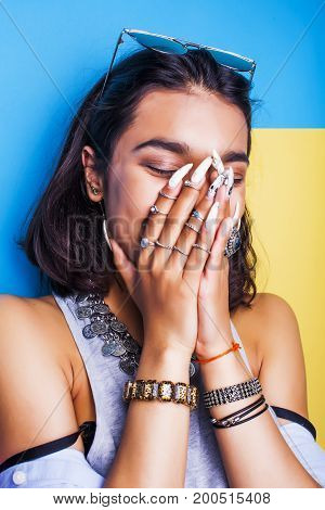 lifestyle people concept. young pretty smiling indian girl with long nails wearing lot of jewelry rings, asian summer happy cool