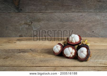Fresh Mangosteen From Rayong Thailand On Wooden Background
