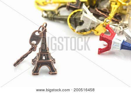 Souvenir key chain of mini eiffel tower (Tour Eiffel) on white background.