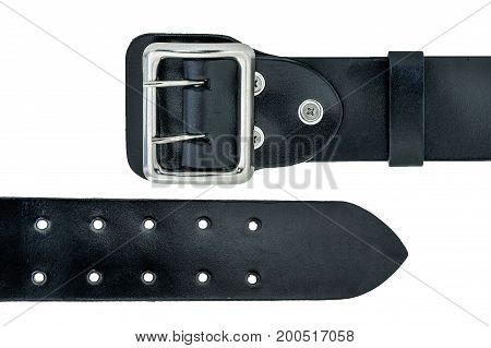 Leather double prong belt tail and prong closeup