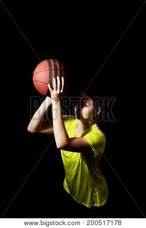 Young sporty woman basketball player holding ball.