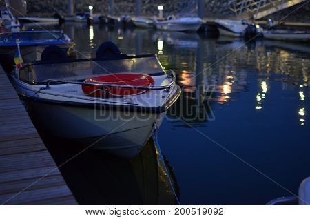 Small boat at the dock in the night time