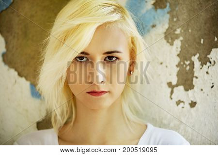 The portrait of angry teenage girl isolated on white.