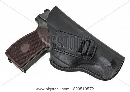 Molded leather holster with handgun. Isolated background