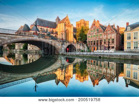 Medieval cathedral and bridge over a canal in Ghent - Gent Belgium Sint - Michielskerk