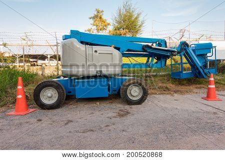 Boom lifting equipment in construction site. Business industry.
