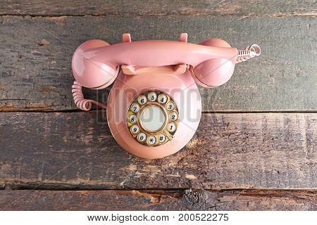 Pink Retro Telephone On Grey Wooden Table