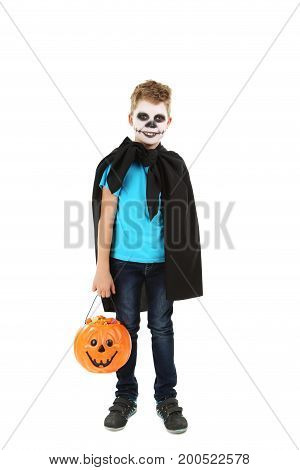 Little boy in halloween costume with basket for candies on white background