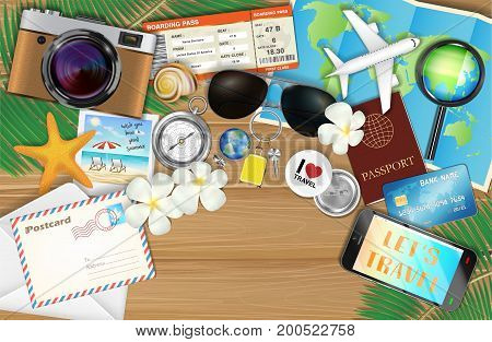 a tropical travel object set on wood background