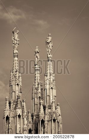 Statue on top of Cathedral in the center of Milan city in Italy.