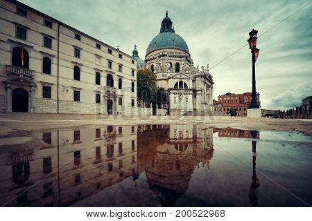 Venice Church Santa Maria della Salute and water reflection in Italy.