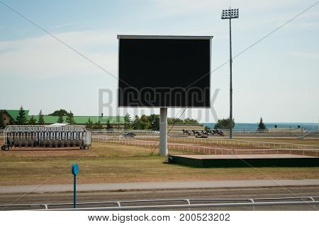 The Big Scoreboard In The Stadium And The Blue Sky