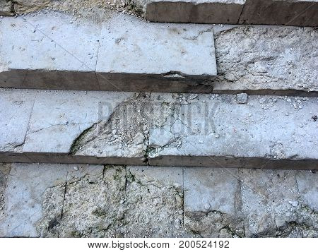 An Ancient Staircase With Steps From A White Marble-strewn Stone