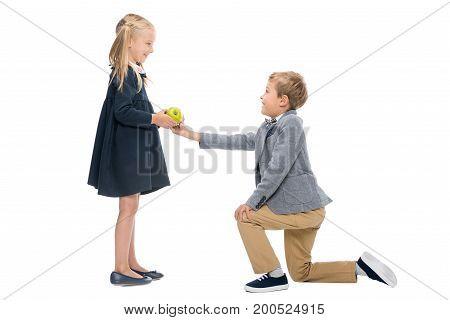 Schoolboy Presenting Apple To Girl