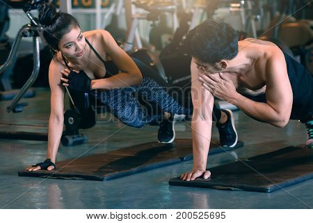 Two People Sporty Put Your Hands On The Floor And Hold The Shoulder For Fitness Workout.