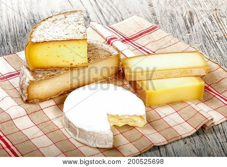 the different french cheeses on a towel