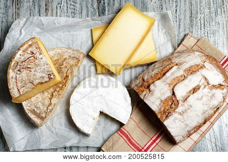 the different french cheeses with a bread