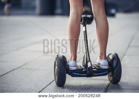 Young Woman Outdoors On Gyro Scooter