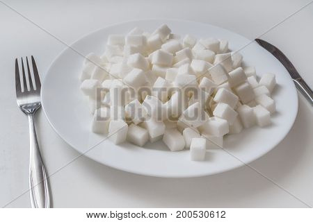 Plate Full Of Sugar Cubec. Unhealthy Eating Concept.