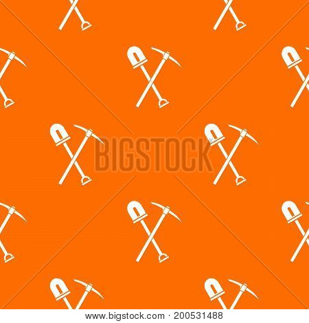 Shovel and pickaxe pattern repeat seamless in orange color for any design. Vector geometric illustration