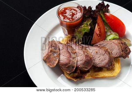 Pork steak with vegetables and garnish and