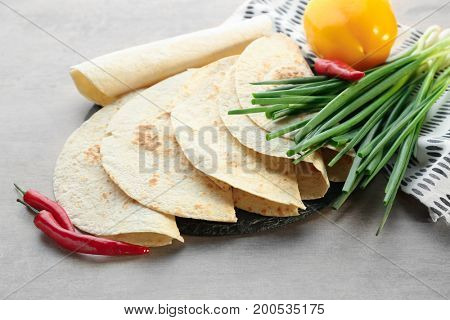 Yummy unleavened tortillas on table